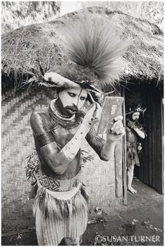 A Young Huli Getting Ready to Perform for Tourists