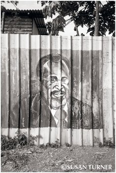 Sir Michael Somare on an Elementary School Fence